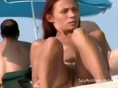 spying on sexy undressed latina at the beach